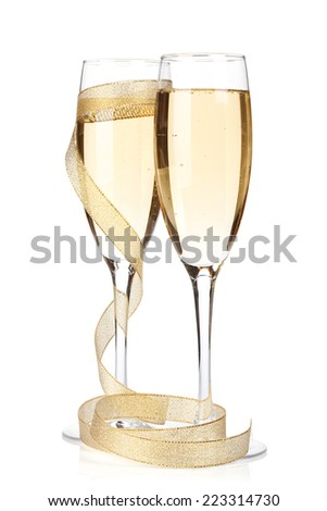 Champagne glasses with golden ribbon. Isolated on white background - stock photo