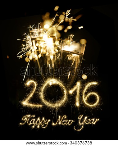 Champagne Glasses With Sparkler Happy New Year 2016 - stock photo