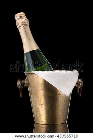Champagne in a bucket of ice on a black background