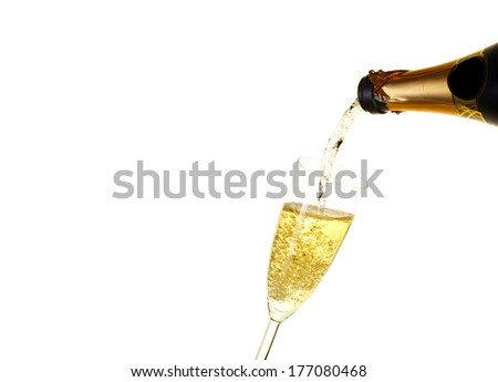 Champagne in a glass a?? winebottle. Isolated on white background - stock photo