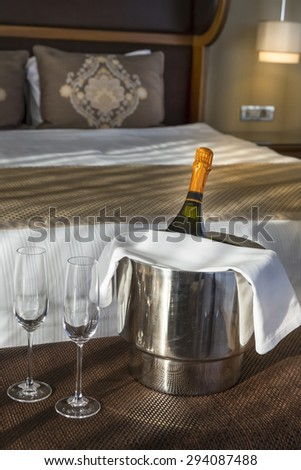 Champagne in a hotel room - stock photo