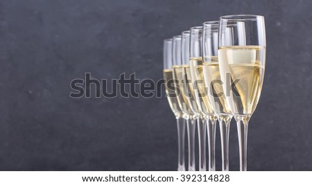 Champagne in glasses in restaurant for wedding day with copy space for text - stock photo