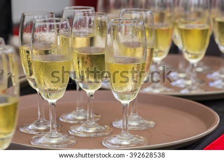champagne in glasses on tray.