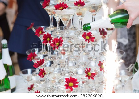 Champagne in glasses with fresh cherry on table - party background