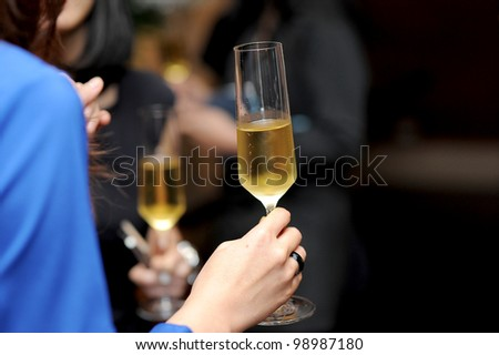 champagne in hand - stock photo