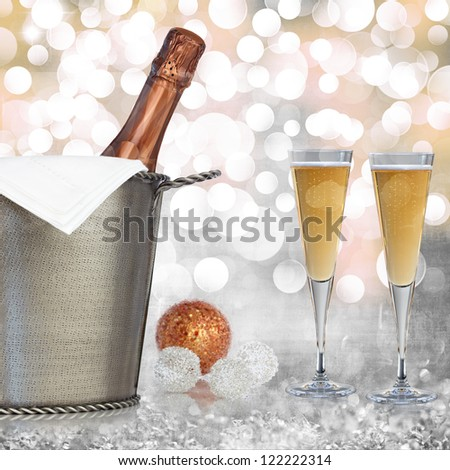 Champagne In Vintage Silver Bucket With Hammered Texture, Bronze Ornaments, & Glasses Of Champagne Wine Over Elegant Grunge Silver, Gold, Purple, Pink Christmas Light Bokeh & Crystal Background - stock photo