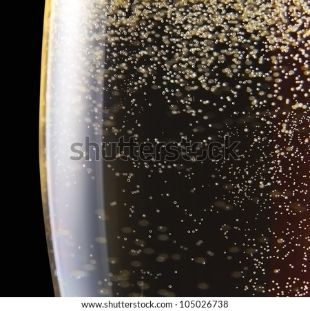champagne in wineglass on a black background.Saved clipping path. - stock photo