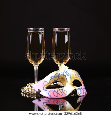 Champagne.New Year's Eve.Celebration. Female carnival mask with glass of champagne - stock photo
