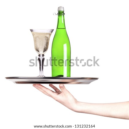 champagne on a silver tray with and hand isolated - stock photo