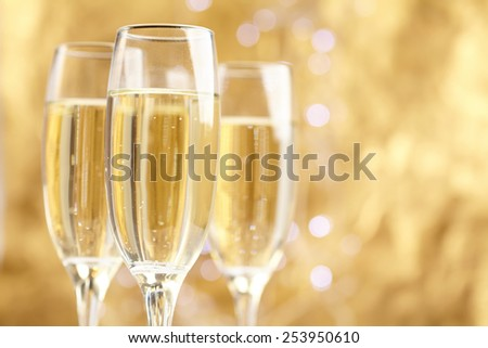 Champagne on gold background - stock photo