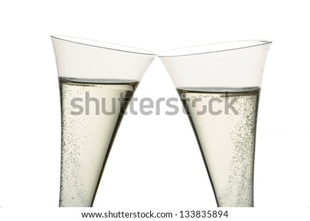 champagne or sparkling wine in a champagne glass. symbolic photo for celebrations, new year and good humor - stock photo