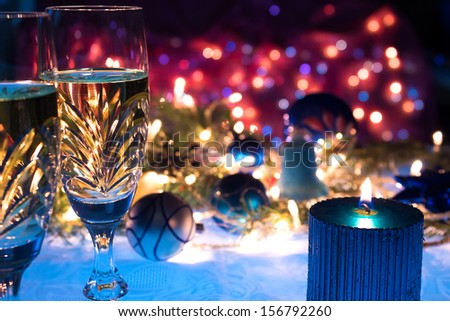 Champagne, ornaments and candles as a New Year decoration, New Year decorations, photography - stock photo
