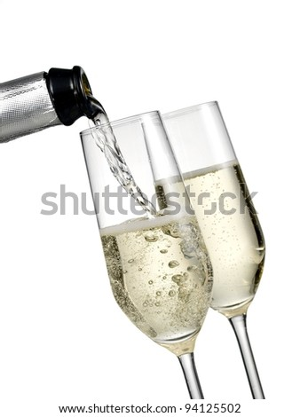 Champagne pour with two glasses - stock photo