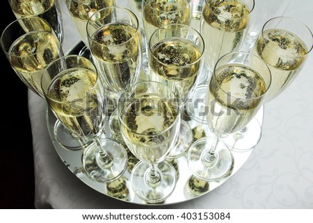 Champagne poured in a glass - stock photo