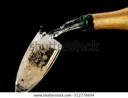 Champagne pouring in a glass