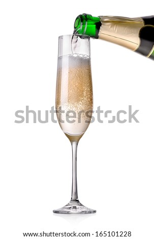 Champagne pouring in a glass isolated on white - stock photo
