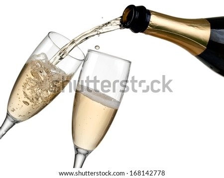 Champagne pouring in two glasses from a bottle - stock photo
