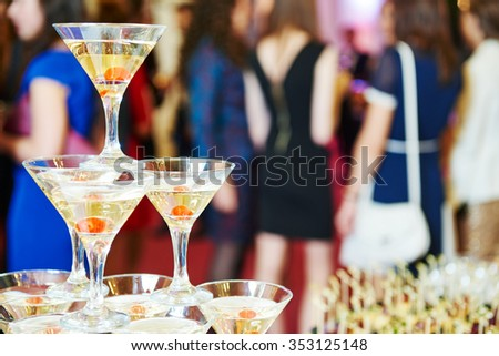 Champagne pyramid with waitress on event, party or wedding banquet reception - stock photo