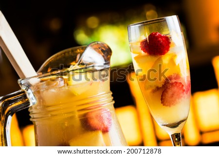 Champagne sangria called tisana in a night summer pub. - stock photo
