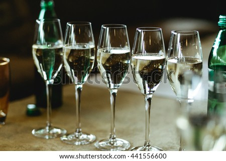 Champagne sparkles in the crystal glasses