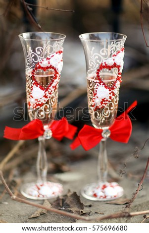 Champagne. Two glasses with bows. Rustic style. Valentine's Day. Birthday. Wedding. Anniversary. Shallow depth of field.