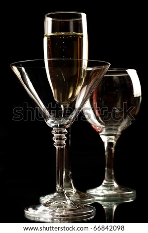 Champagne, wine and martini glasses isolated on black background