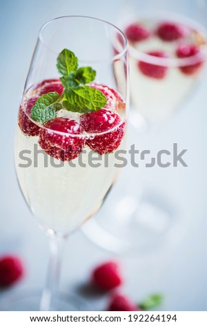 champagne with fresh raspberries - stock photo