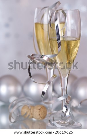 Champagne with silver baubles - stock photo
