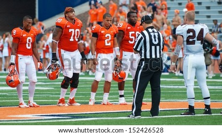 CHAMPAIGN,IL-AUGUST 31: Illinois Fighting Illini and SIU Salukis meet at the 50 yard line for the coin toss before the game on Saturday, Aug 31, 2013.