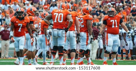 CHAMPAIGN,IL-AUGUST 31: Illinois offensive line prepares for the next play during a game agains SIU on Saturday, Aug 31, 2013.