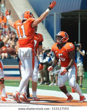 CHAMPAIGN,IL-AUGUST 31: Illinois tight end Matt LaCosse (11) celebrates with running back Donovonn Young (5) after Young scored a touchdown during the game against SIU on Saturday, Aug 31, 2013.