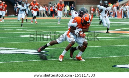 CHAMPAIGN,IL-AUGUST 31: Illinois wide receiver Ryan Lankford (12) is tackled by SIU corner back Terrell Wilson (5) during the first quarter of a game on Saturday, Aug 31, 2013.