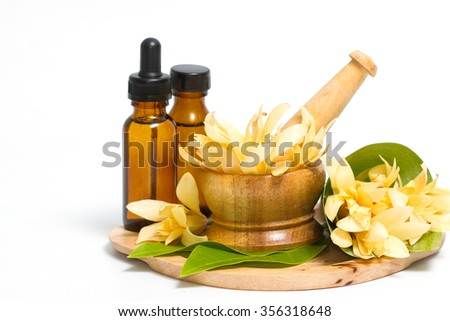 Champaka essential oil decoration for Thai spa setting - stock photo
