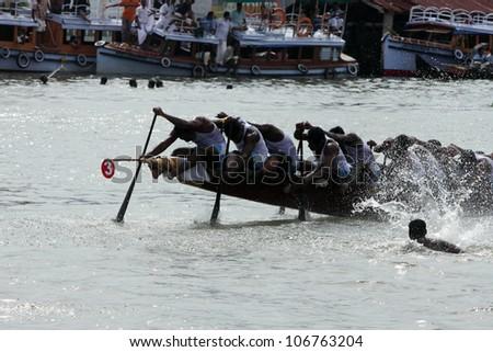 CHAMPAKKULAM, INDIA - JUL 03 : A team participate in the Snake boat racing at the banks of Pumba river on July 03, 2012 at Champakkulam, Kerala, India. - stock photo
