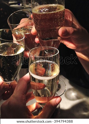 Champayne glasses clinking celebrate - stock photo