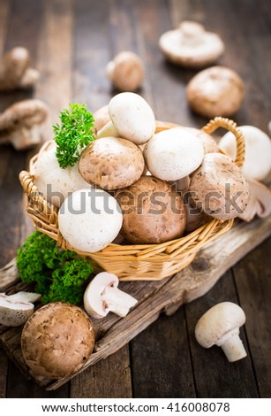 Champignon mushroom on the wooden table - stock photo