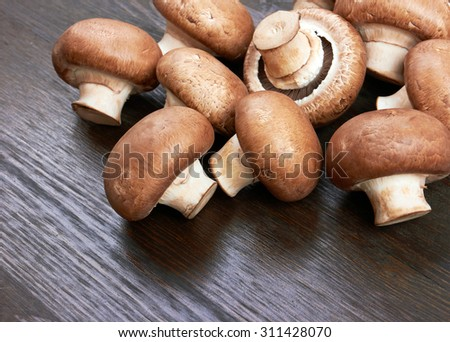 Champignon Mushroom on wood background - stock photo