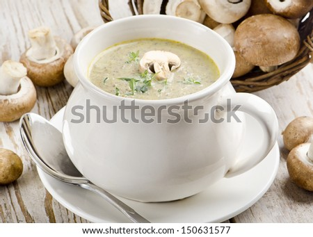 Champignon mushroom soup and mushrooms with parsley