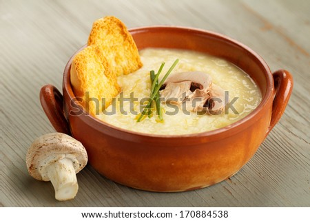 champignon mushroom soup with chives and croutons - stock photo