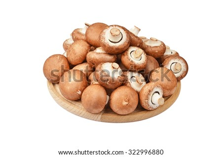 Champignon (True mushroom) on wooden board, isolated on white background - stock photo