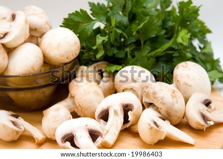 champignons with parsley on the board