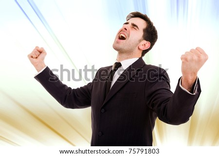 Champion business man standing with fists clenched in victory