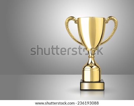 champion golden trophy on gray background - stock photo