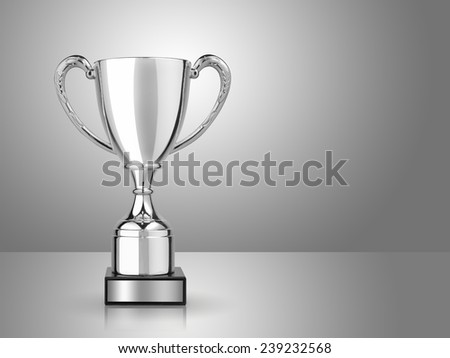 champion silver trophy on gray background - stock photo