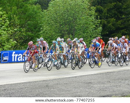 "CHAMROUSSE, FRANCE - JUN 11: Professional racing cyclists ride UCI WORLD TOUR "" CRITERIUM DU DAUPHINE LIBERE"" on June 11, 2010 in Chamrousse pass, Isere, France. - stock photo"