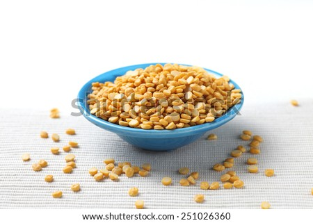 chana daal (gram) in a ceramic bowl.