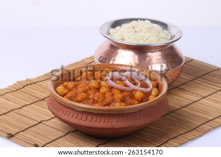 Chana masala, chickpeas with cooked rice, classic indian meal - stock photo