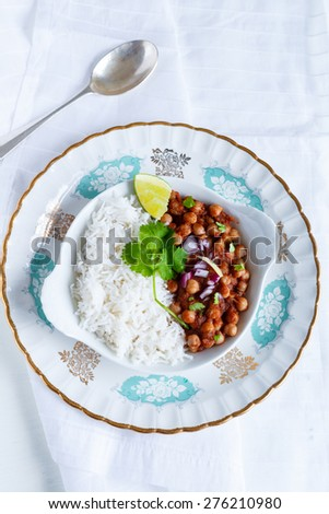 Chana Masala - Spicy Chickpeas Curry garnished with Coriander leaves and ginger juliennes  served along with Basmati Rice  North Indian Meal , Indian Dish  - stock photo