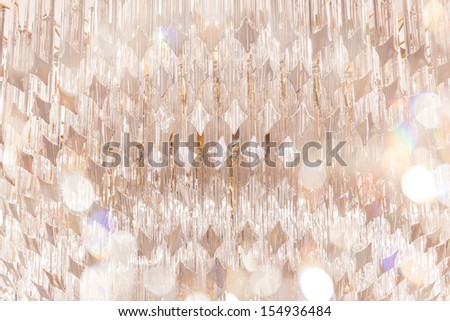 chandelier in luxury hotel with bokeh as foreground - stock photo