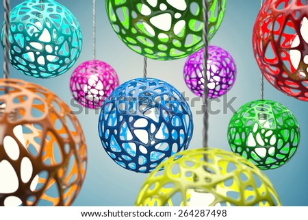 Chandeliers of different colour hang on a wire - stock photo